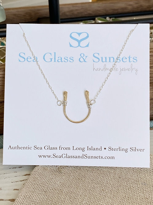 Wire wrapped horseshoe necklace