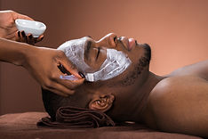 Therapist Applying Face Mask To Young Af