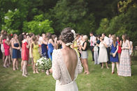 Bride throws bouquet at her country wedding at Timber Lodge Ranch in Arkansas.