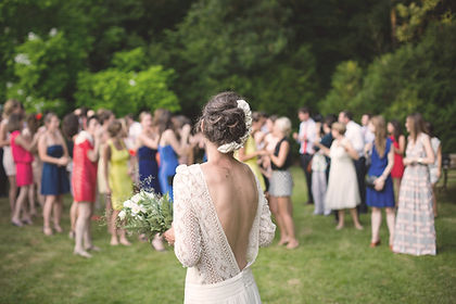 Bride and guests  in the garden at large wedding venue