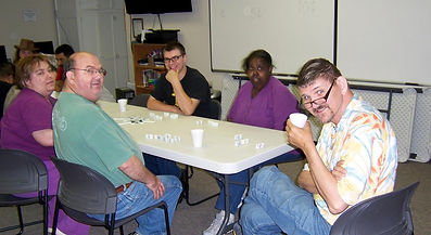 group of people playing dominos