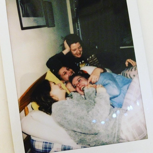 Polaroid photo of best friends laughing together