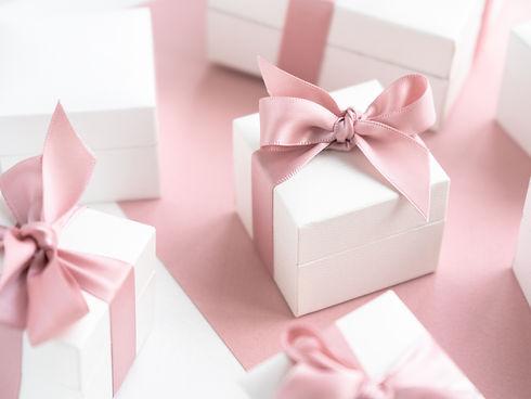 Gift boxes wiyh powdery ribbon. Powdery