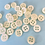 Thumbnail: Bag of small white pearlescent buttons