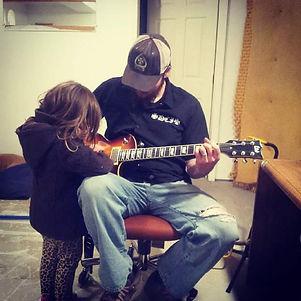 Tony and Rogan playing guitar