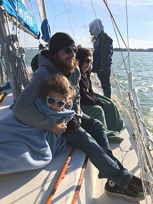 Tony Madden with Amberle and Rogan on a sail boat