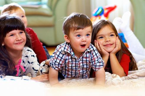 group of happy kids watching tv at home.jpg