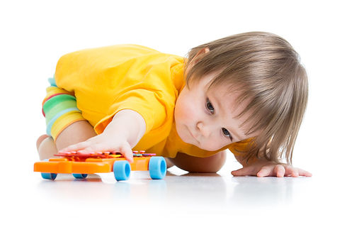 little boy toddler playing with toy car isolated.jpg