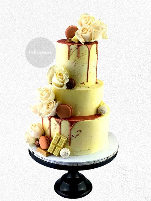 Three Tiered Rose Gold Drip Wedding Cake