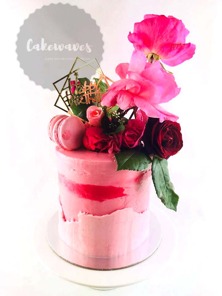 Pink Floral Cake with macarons