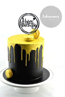 elegant black and gold drip cake