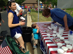 July 4 2017 - Cyndi Miller confers with one of our youngest customers