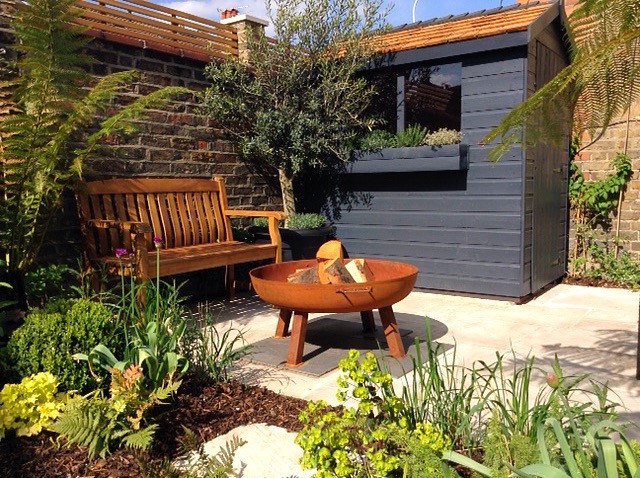 Midhurst garden with fire pit and shed