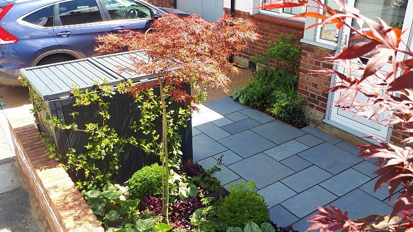 Front garden with parking space, paving and storage