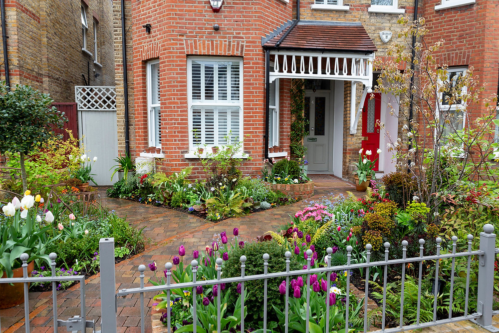 Elegant front garden with brick path