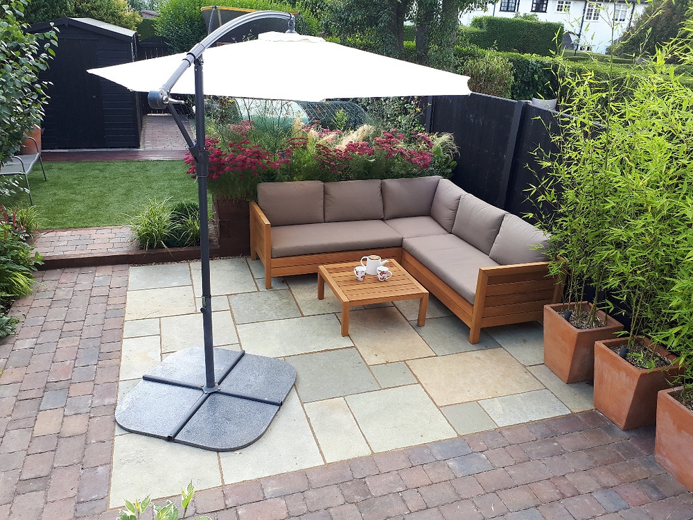 Family garden with terrace, trampoline and rabbit run