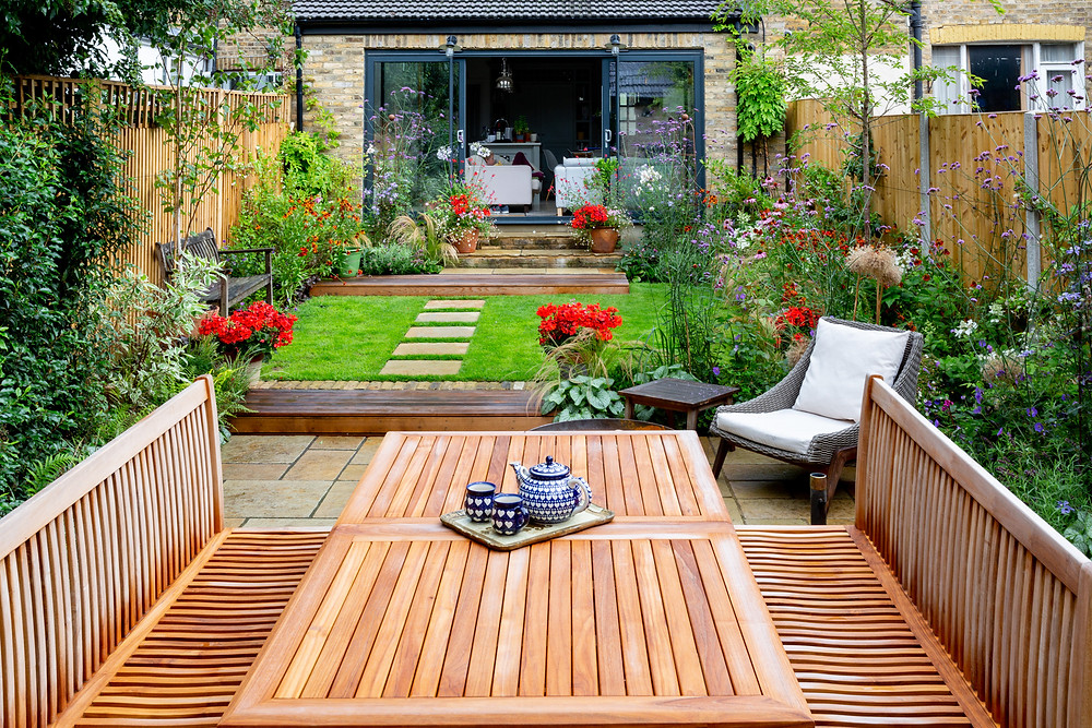Back garden with lawn, borders and entertaining terrace