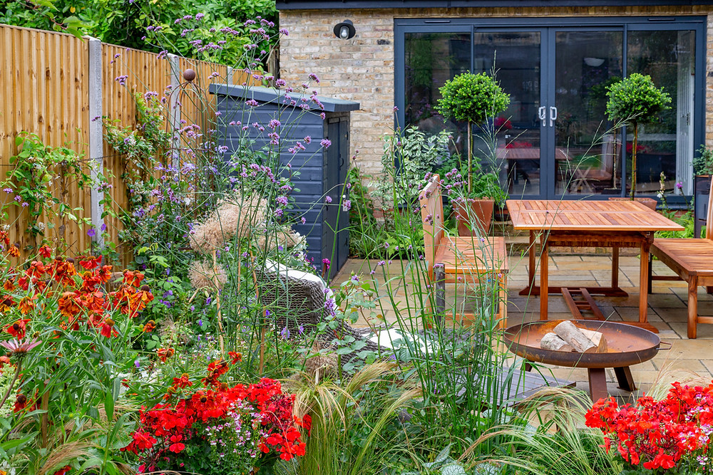 Back garden patio terrace with garden room and storage