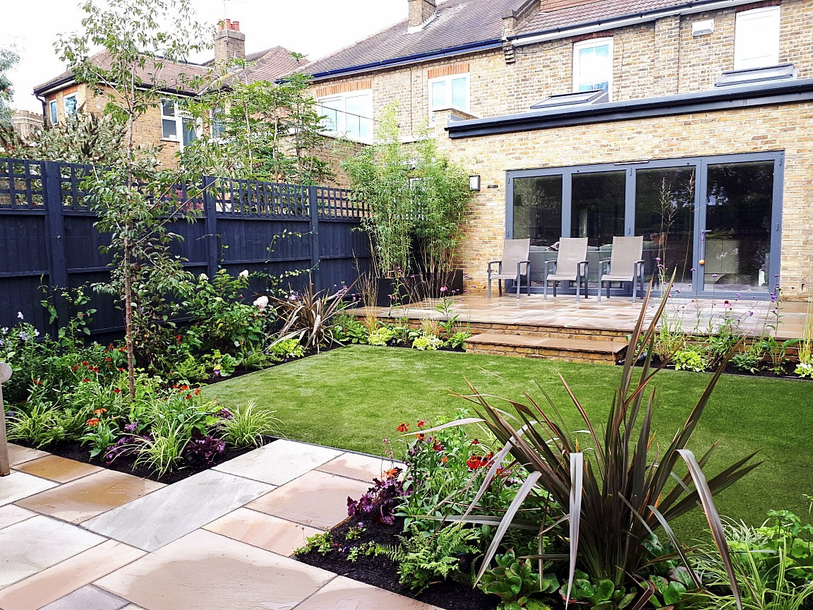 Rear Garden with Large Terrace and Generous Borders