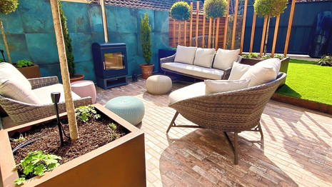 Chic London Family Garden with Outdoor Wood Burner and Bespoke Planters