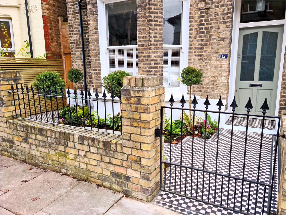 Contemporary Classic London Front Garden with Victorian Tiling