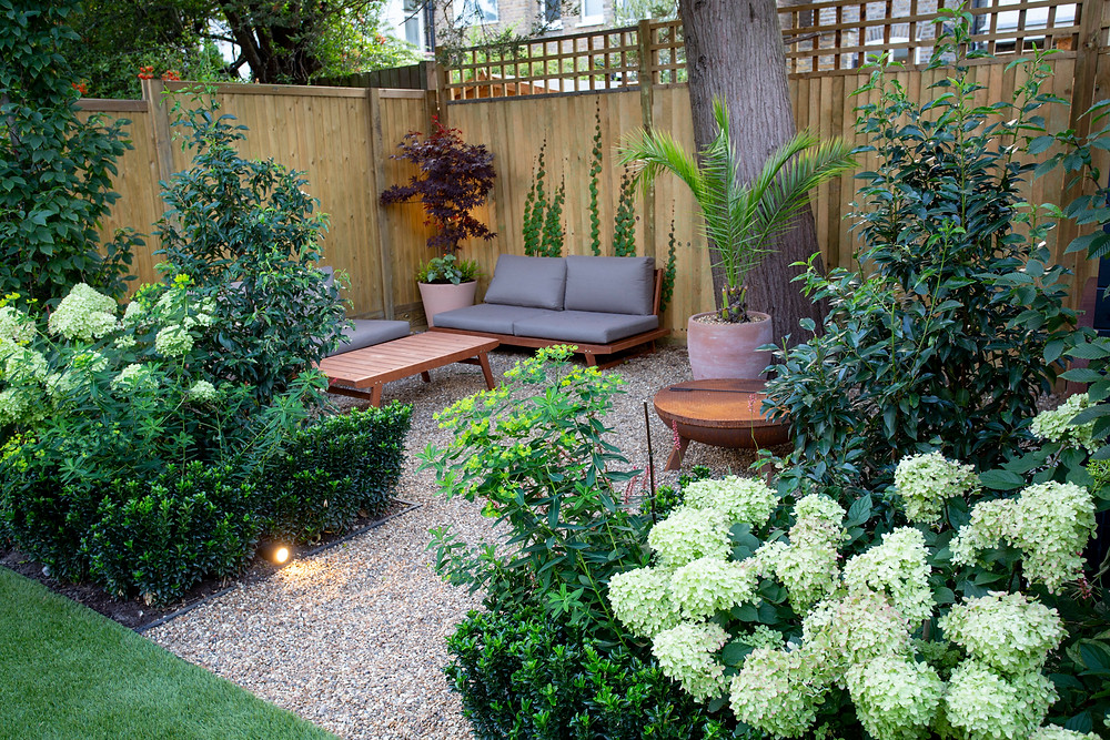 Secluded sofa area at the rear of the garden