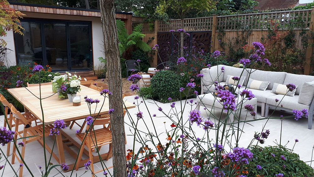 Garden dining and terrace area with verbena