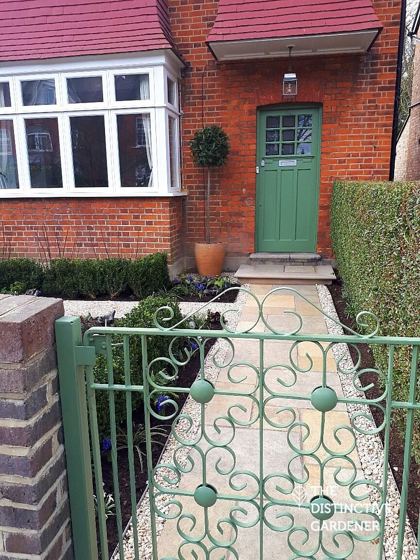 The gate, path and door after