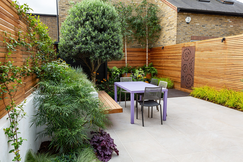 City garden with dining area and contemporary features