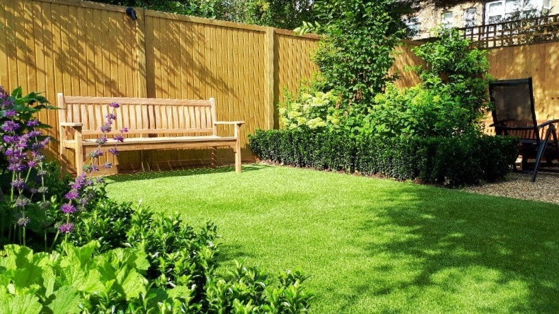 Family Garden with Terrace, Lawn and Secluded Seating Area