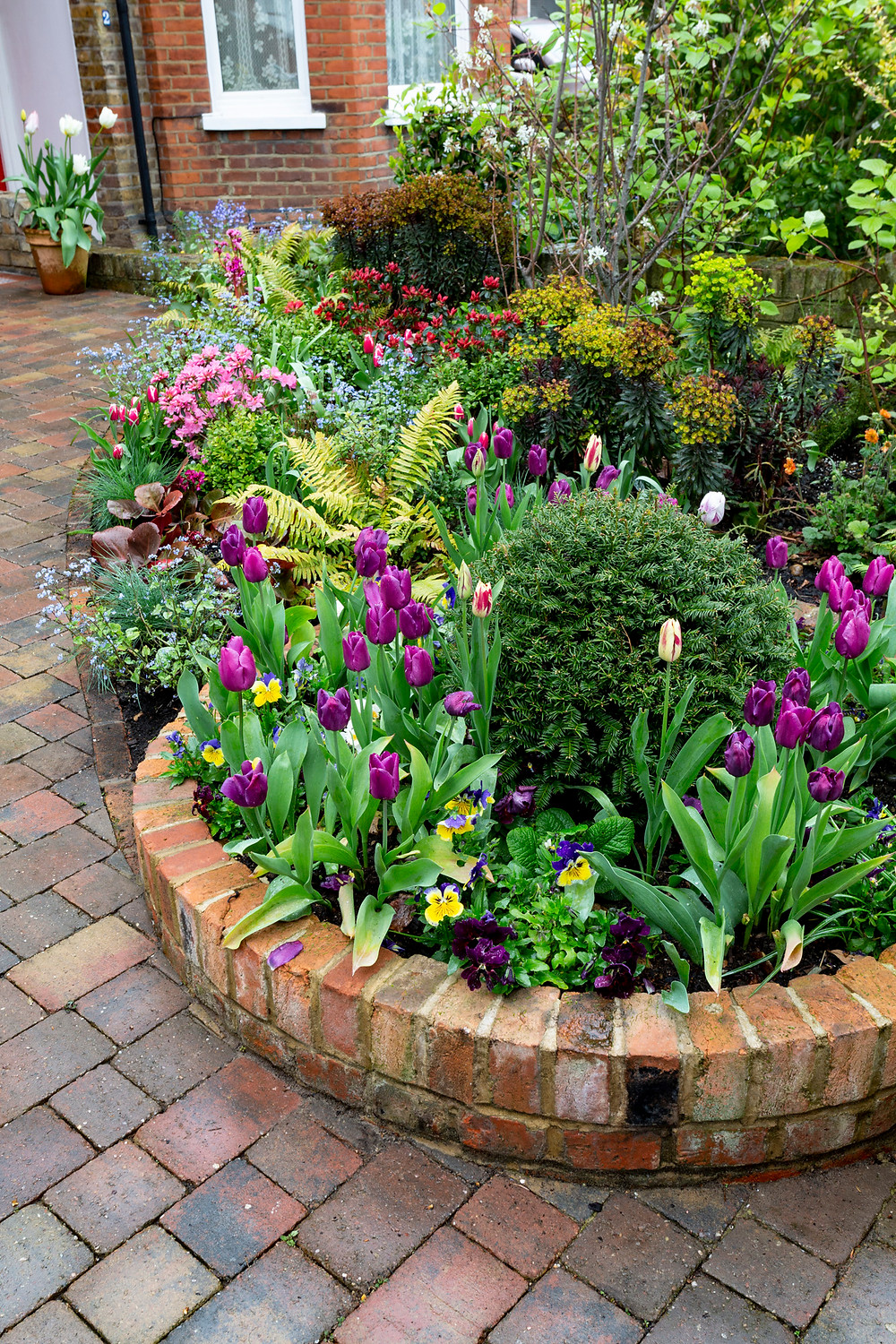 Circular brick flower beds