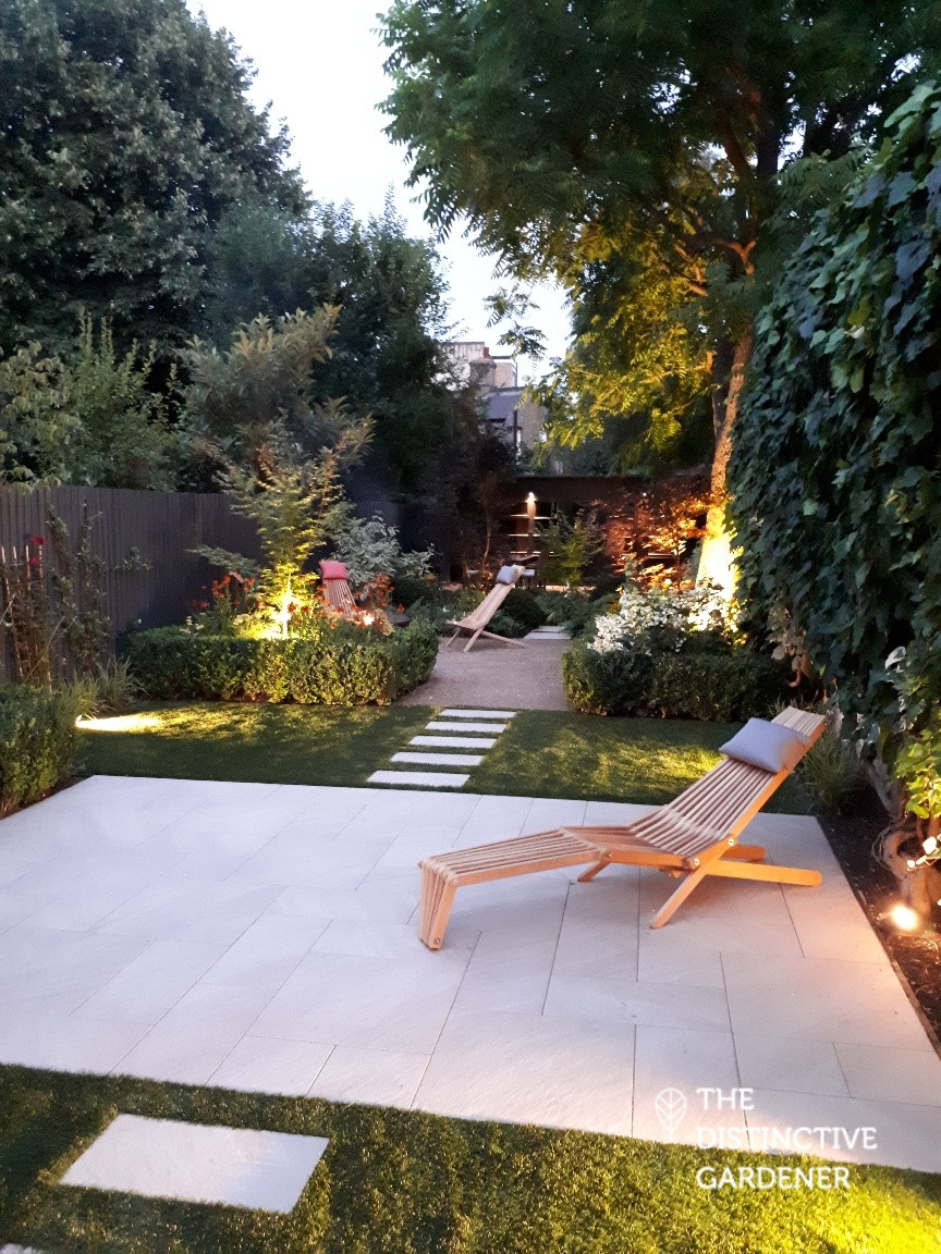 The garden lit up at night