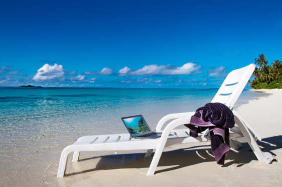 a laptop and a relaxed beach at the beachside