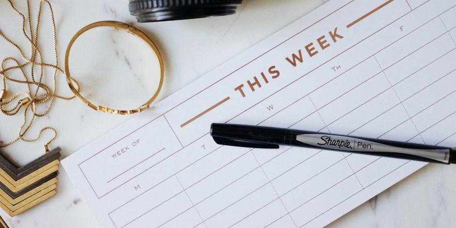 A schedule of a week alongside a pen
