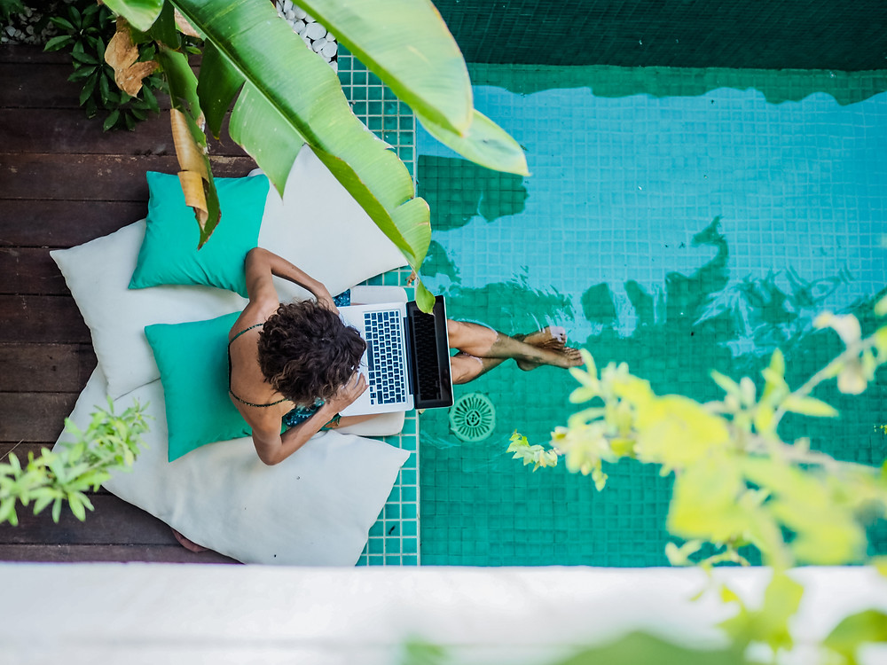 A woman working on the side of a pool