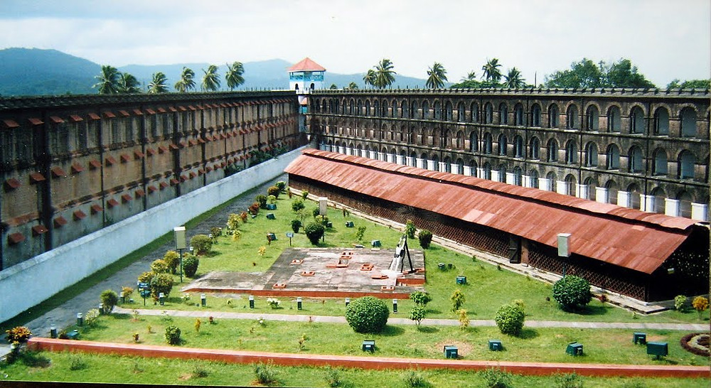 Two wings of the Cellular Jail with a garden