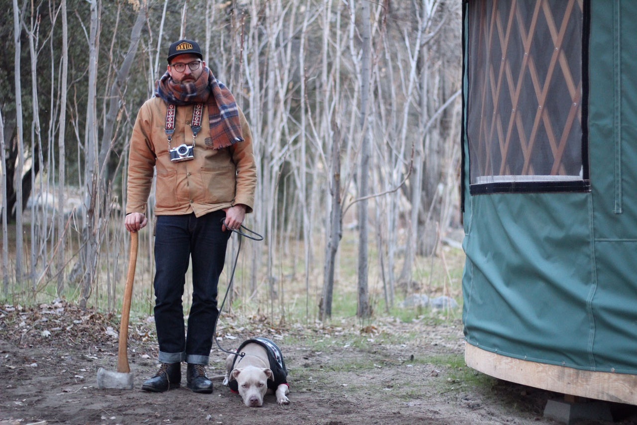 man and his pitbull in the woods