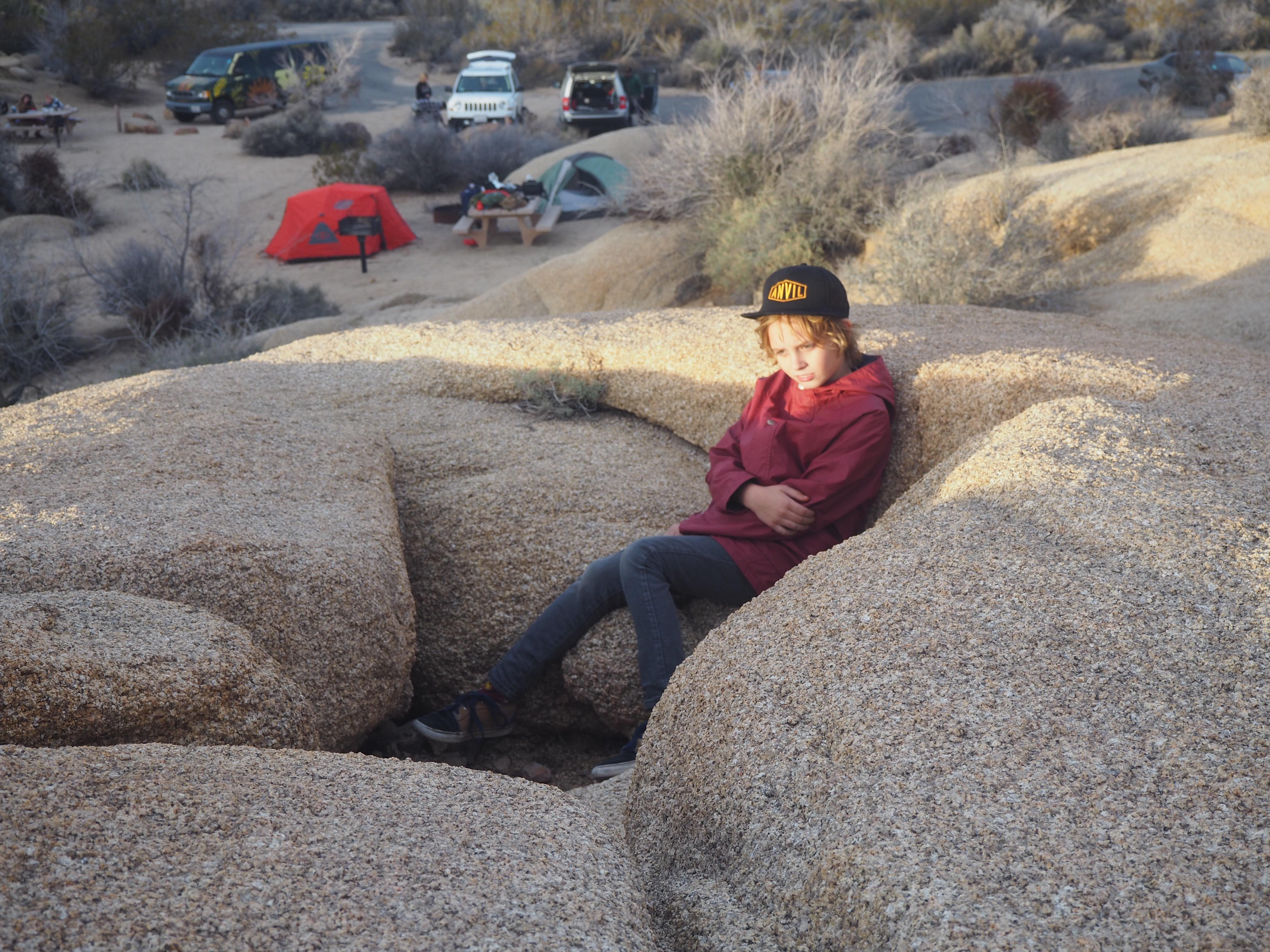 jonah sitting on a boulder