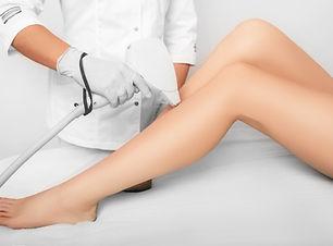 Dublin near me D1 beautician removes hair on beautiful female legs using a laser. hair rem