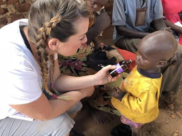 Kellie working at an herbal medicine clinic in Jinja, Uganda, 2018