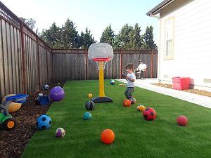 boy playing on artificial turf in petaluma