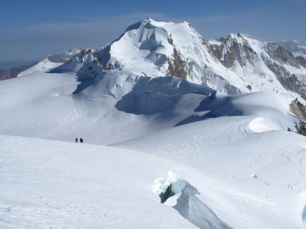 climbers on the Chachacomani glacier with Chearoco in the background, Bolivia