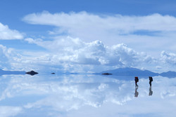 crossing the flooded salar