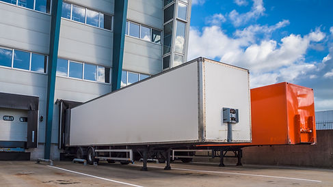 colored-truck-trailers-loading-G9374NK.j