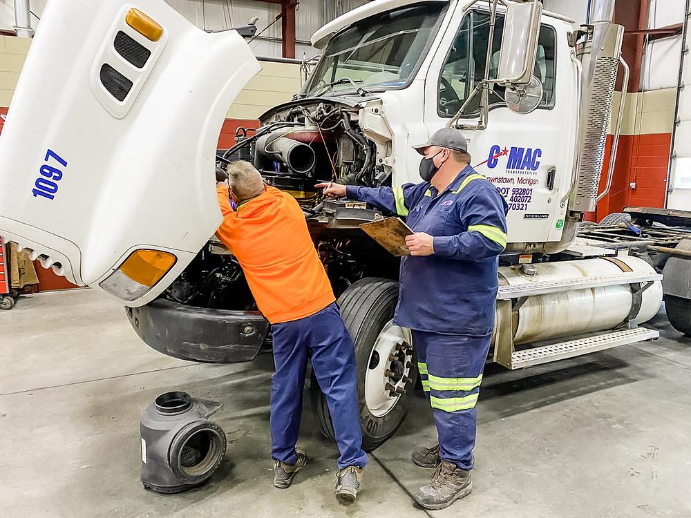 Gordan McCue Helps Another CMAC Mechanic