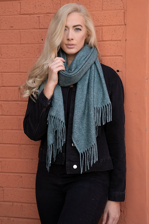 A Plain Green Blanket Scarf With A Tassel.