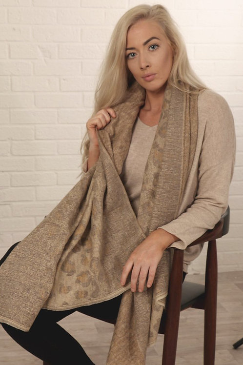 A Cream And Mustard Scarf With A Large Leopard Print Pattern.
