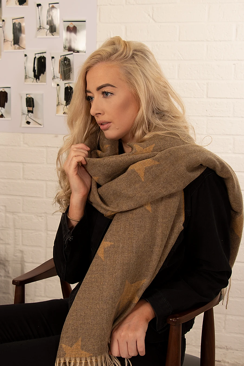 A Mustard Tasseled Blanket Scarf With A Star Pattern.
