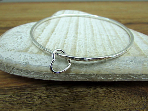 Handmade Hammered Sterling Silver Bangle With Open Heart Charm