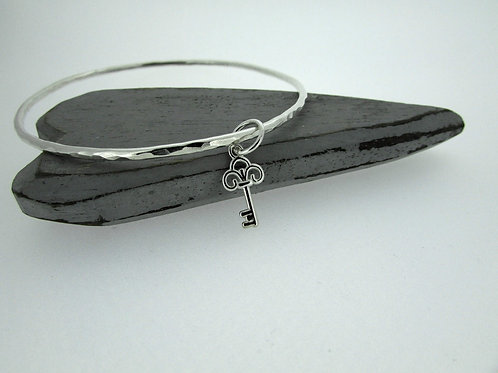 Handmade Hammered Sterling Silver Bangle With Key Charm